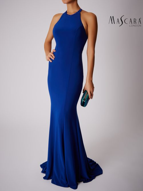 Young woman wearing a Mascara Collection Style MC181360G Jersey Halter Neck Long Dress with Sparkle Strap Back Detail in Royal Blue from Prom Dress Boutique Silhouette London.