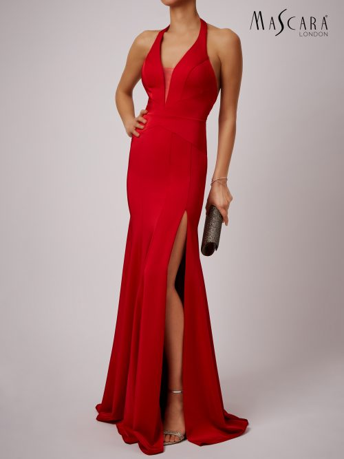 Young woman wearing a Mascara Collection Style MC181489 Jersey Halter Plunge Neck Long Dress with open back in Red from Prom Dress Boutique Silhouette London.