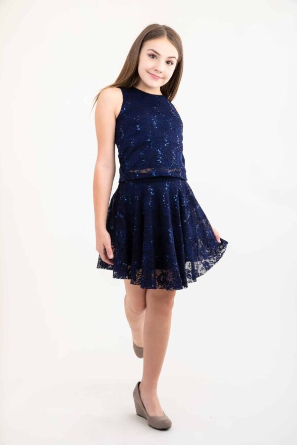 Teenage Girl wearing a Navy Lace and Sequin Skater Skirt with matching top from Silhouette London, a Girls Party Dress Boutique in Greater London