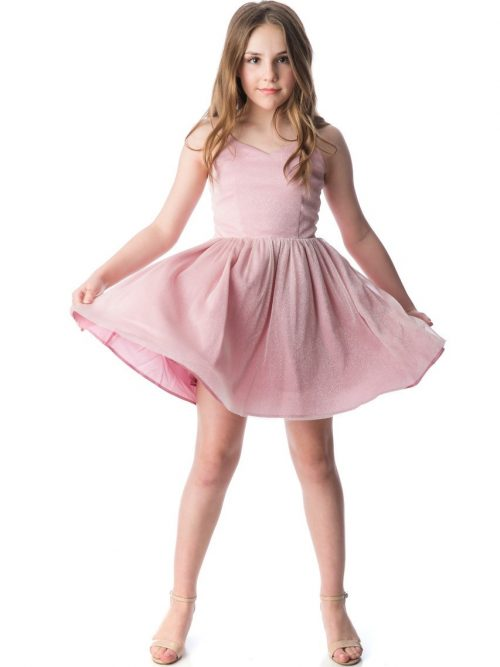 Teenage Girl wearing an Un Deux Trois Pink Shimmer Dress with spaghetti straps and skater skirt from Silhouette London a Batmitzvah Dress Specialist Boutique in Greater London