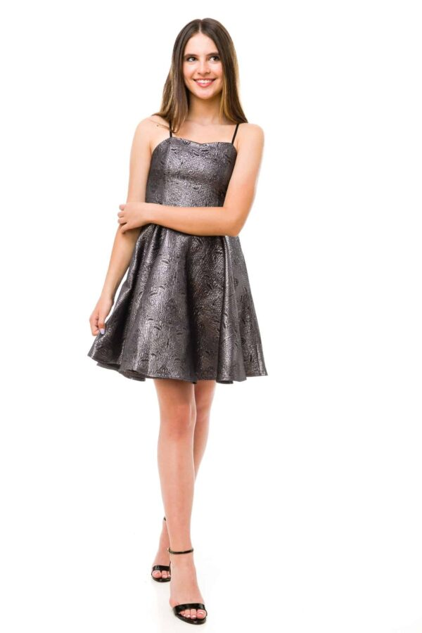 Teenage Girl wearing an Un Deux Trois All over Shimmer Jacquard Dress in Pewter with spaghetti straps and skater skirt from Silhouette London, Teen Party Dress Boutique in Greater London