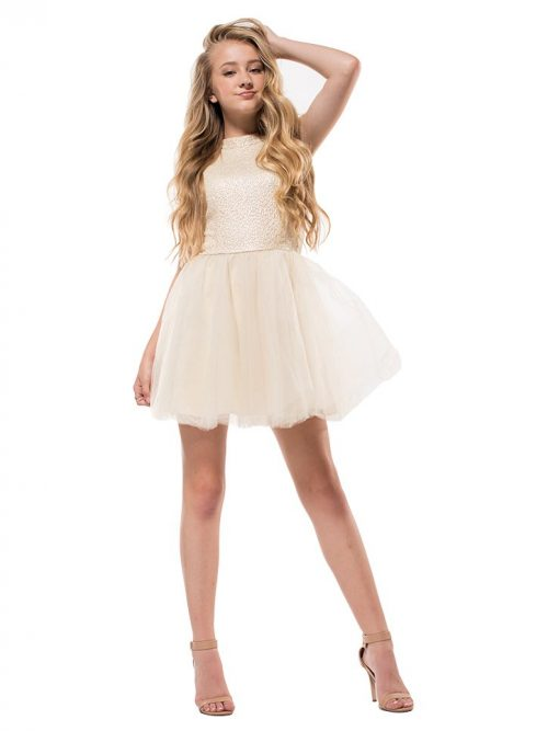 Young blonde hair girl wearing a Miss Behave Ruby Dress in Ivory. Embroidered halter neck bodice with full tulle skater skirt from Silhouette London, Girls party dress specialists in London