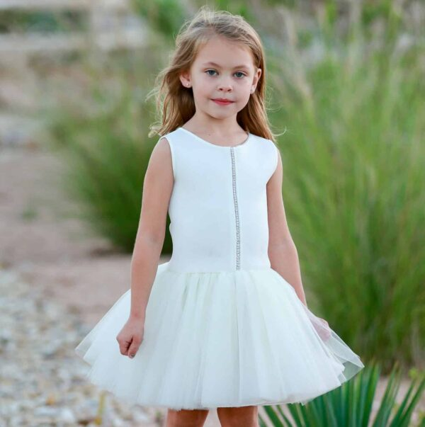Young girl wearing Dolls and Divas Couture Sheri Tutu Dress in Ivory, Scuba top with diamante detail and full tulle skirt, from Silhouette London, a girls party fashion boutique in Harrow, Greater London