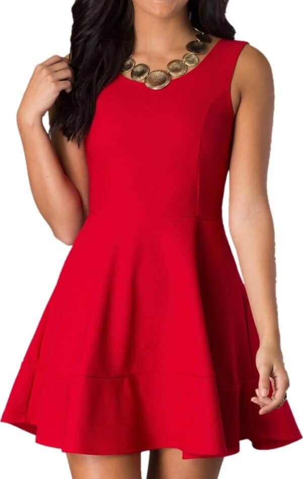Teenage girl wearing a Red Cheryl Creations Red Sleeveless Skater Zip Pique Prom Dress from Silhouette London.