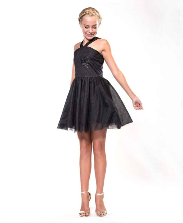Blonde girl wearing a Miss Behave Stephanie Dress in Black. Embroidered halter neck bodice with full tulle skater skirt from Silhouette London, Girls party dress specialists in London