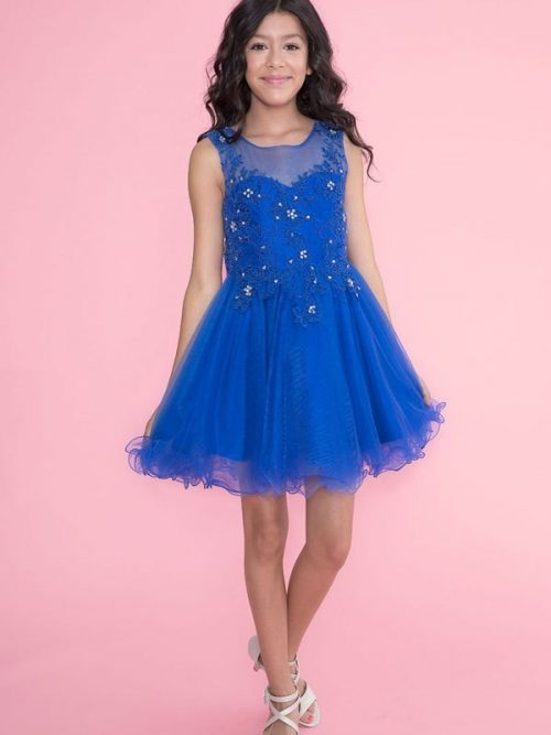 Young girl wearing a Calla Collection Dress TY002 in Royal Blue. Stunning lace and tulle dress with illusion neckline and full tulle skirt with scalloped edge from Silhouette London, Girls party dress specialists in London.