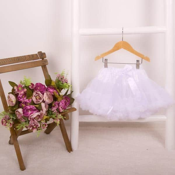 White Tutu. Soft double layered soft tulle with gorgeous ruffle edges and satin elasticated waistband and satin bow from Silhouette London, Girls party dress specialists in London.