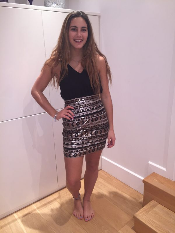 Teenage Girl wearing AX Paris Black Chiffon top and stunning aztec design sequin bodycon skirt from Silhouette London, a Party Dress Boutique in London.