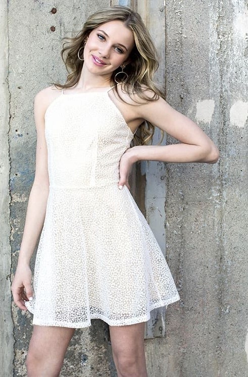 Teenage Girl wearing a Miss Behave Ivory Lace Skater Dress available at Silhouette London,Teen Prom and Party Dress Specialists in Greater London