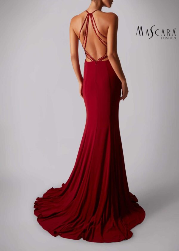 The back of a young woman wearing a Mascara Collection Style MC181360G Jersey Halter Neck Long Dress with Sparkle Strap Back Detail in Wine from Prom Dress Boutique Silhouette London.