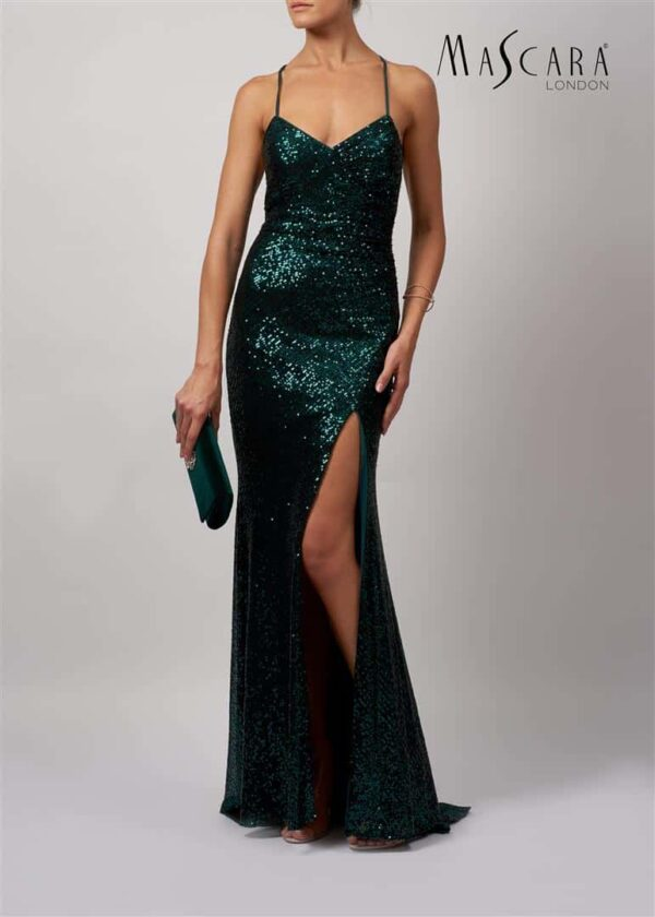 Young Woman wearing Mascara Collection Style MC186119 Sequin Crossover ruched Long Prom Dress in Forest Greenfrom Prom Dress Boutique Silhouette London.