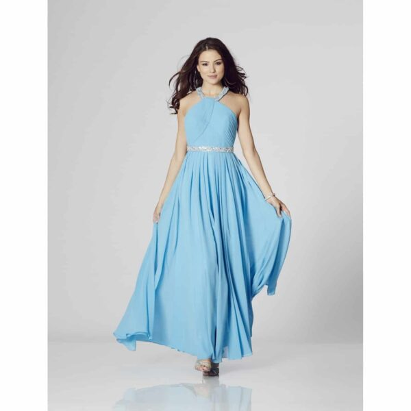 Brunette model wearing a Tiffany Illusion Prom Rio Dress in Blue. Stunning halter neck flowing chiffon prom dress with pleated halter neck bodice with crystals at the neckline and waistband and stunning T back detail from Prom Dress Boutique Silhouette London.