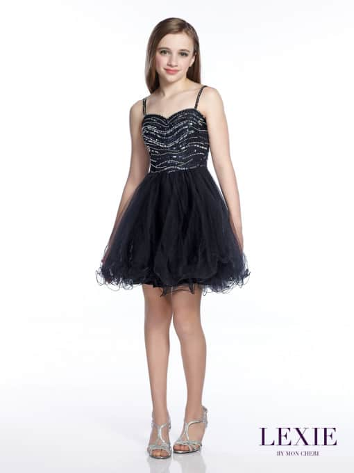 Young girl wearing a Mon Cheri Lexie Dress Style TW21544 in Black. Sleeveless tulle and charmeuse above-the-knee A-line dress from Silhouette London, Girls party dress specialists in London.