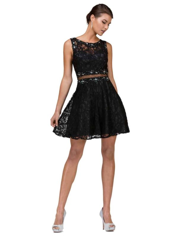 Young woman wearing Dancing Queen Dress Style 2053 in black. Lace with crystal embellishment and mesh detail to give the illusion of a two piece with a skater skirt. From Silhouette London a Teen Prom and Party Boutique in Greater London.