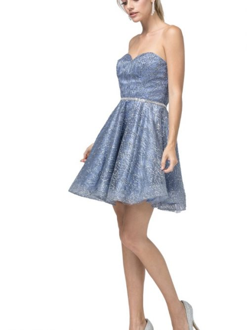 Young Woman wearing Dancing Queen Dress Stle 3136 in Steel Blue. All over glitter shimmer and crystal waistband with sweetheart strapless neckline and full skater skirt from Silhouette London, a Teen Prom and Party Dress Boutique in Greater London.