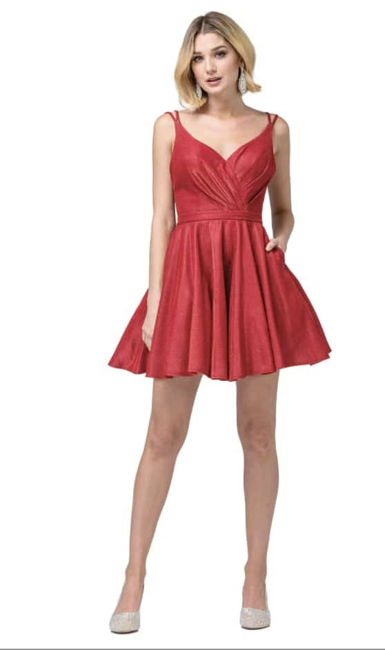 Young Woman wearing Dancing Queen Dress Style 3183 in Red. Ruched Sweetheart neckline and spaghetti straps with full skater skirt from Silhouette London, a Teen Prom and Party Dress Boutique in Greater London.