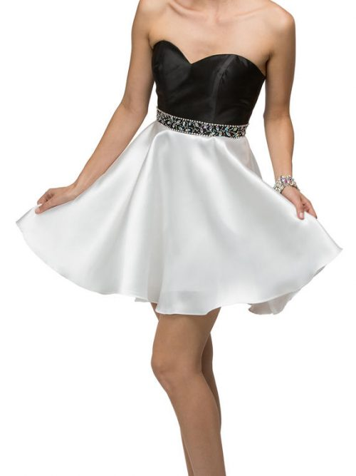Young woman wearing strapless black and white satin dress with black sweetheart neckline, full white skater skirt and embellishment on the waistband. From Silhouette London, Prom and Party Boutique in Greater London.