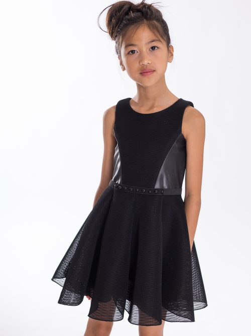 Young girl wearing Zoe Ltd Sloane Dress from Silhouette London a Greater London Boutique selling Girls and Teen Prom and Party Dresses