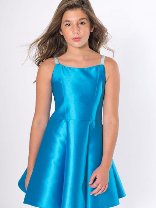 Young Girl wearing Zoe Limited Jenna Dress in Turquoise from Silhouette London a Girls Party Dress Boutique in Greater London