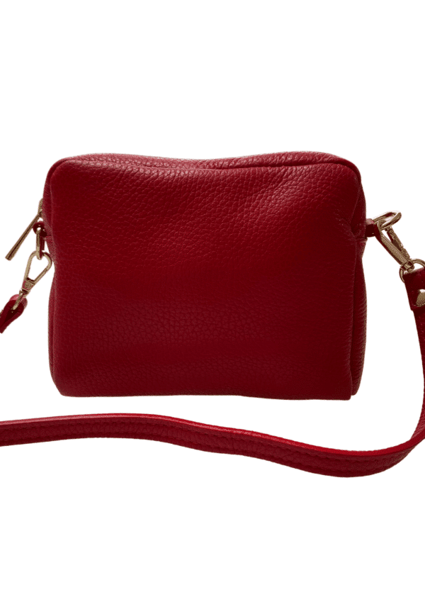 Red Leather crossbody bag size 16cm x 12cm x 5cm on a white background available from Silhouette London a teen fashion boutique in London