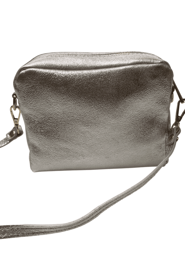 Silver leather clutch bag with matching crossbody strap on a white background size 16x12x5cm available from Silhouette London, a teen fashion boutique in greater london
