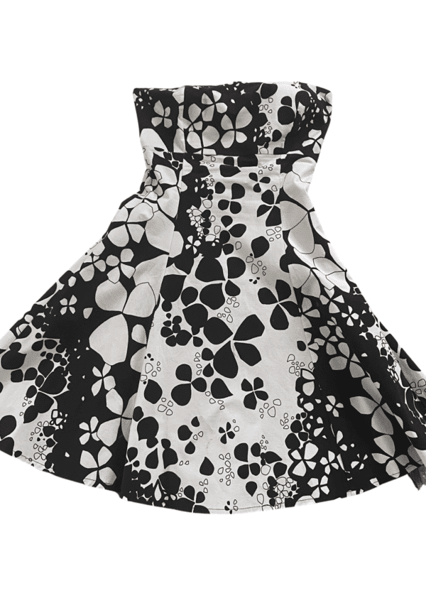 Stunning black and cream floral strapless party dress on a white background available at Silhouette London, a teen party fashion boutique in Greater London