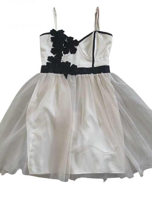 Pre-Loved Cream and Black Lipsy Party dress with tulle overlay and black flower detail on the corset bodice on a white background, available from Silhouette London and Teen Fashion Boutique in Greater London